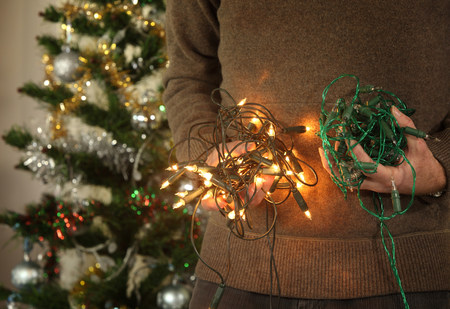 new age: Mature male holding christmas tree lights