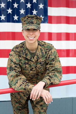 proudly: Servicewoman in camouflage by US flag