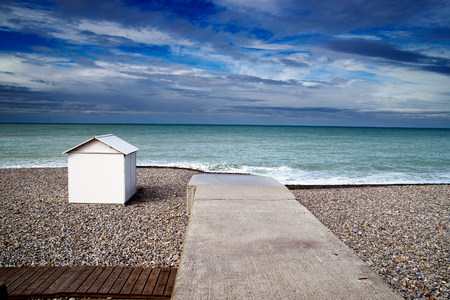 vacant land: White beach hut on shingle beach LANG_EVOIMAGES