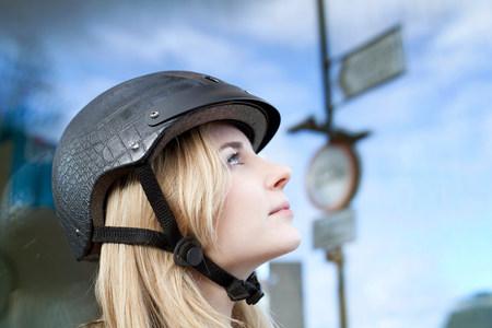 Woman wearing bicycle helmet outdoors