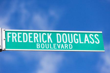 frederick street: Frederick Douglass Blvd street sign LANG_EVOIMAGES