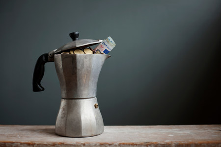 affluent: Coffee pot with Euros inside