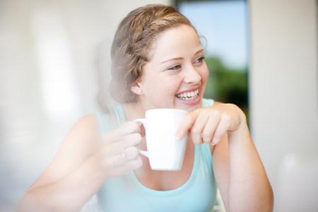 tea breaks: Young woman holding mug