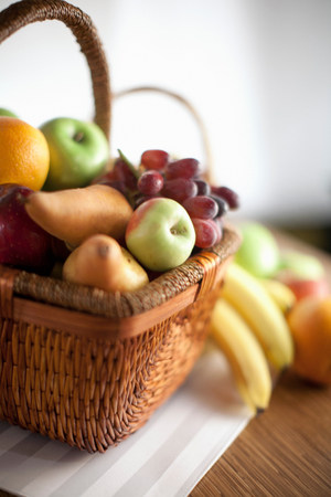 nourishing: Basket of fruit on table