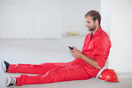 Construction worker sitting on floor taking a break