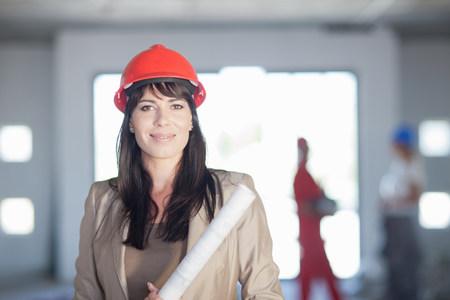 Female architect with blueprint