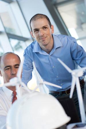 Engineers with model wind turbines