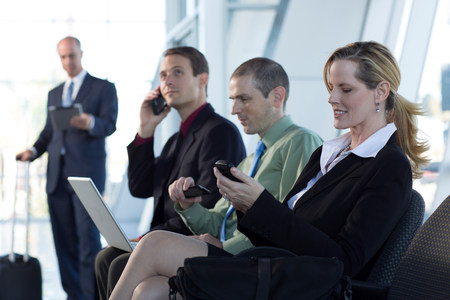 Mature businesswoman using cell phone