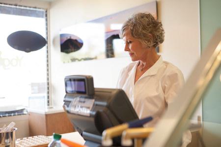 salespeople: Cashier wearing uniform in store