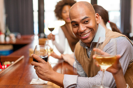 Man enjoying glass of wine and chatting LANG_EVOIMAGES