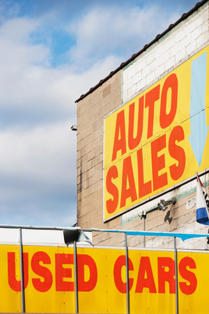 arrears: Auto sales sign