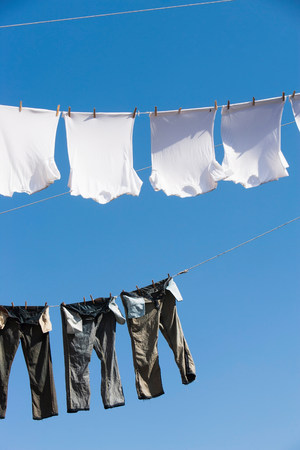 T shirts and trousers on clothes line LANG_EVOIMAGES