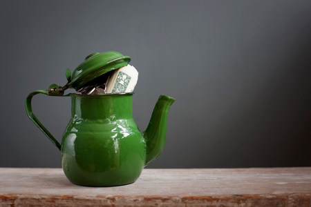 Teapot with dollar notes inside