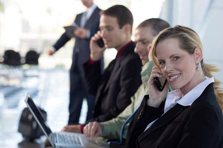 Mature businesswoman on cell phone LANG_EVOIMAGES
