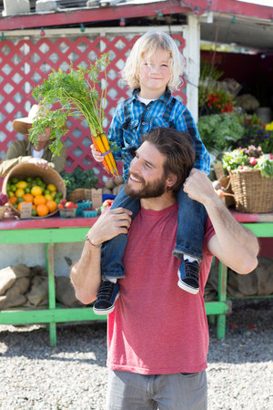 bunched: Father and son at farmer?s market