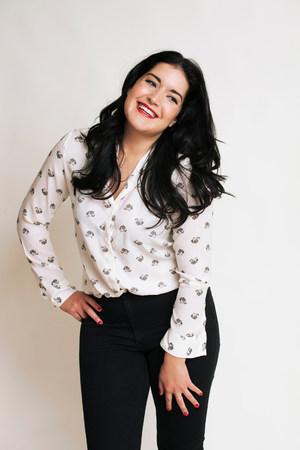 fuller figure: Young woman wearing patterned blouse LANG_EVOIMAGES