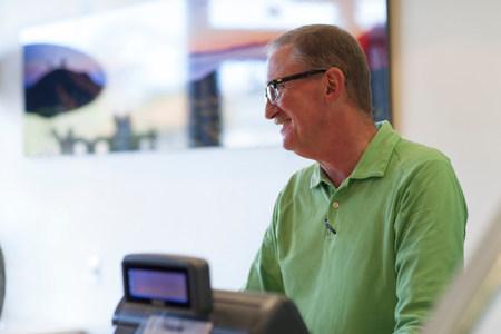cash register building: Cashier talking in store