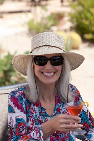 Older woman having cocktail outdoors LANG_EVOIMAGES
