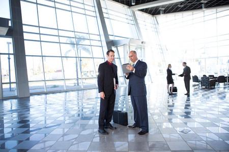Two businessmen using digital tablet