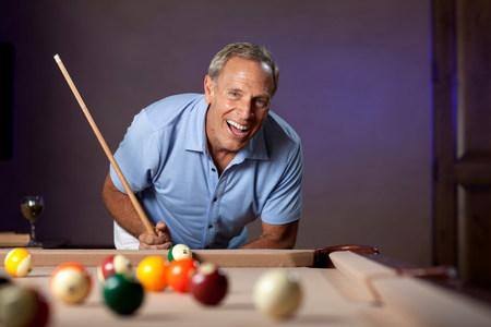 pool cues: Older man playing pool