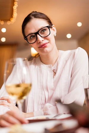 cynical: Woman having a drink LANG_EVOIMAGES