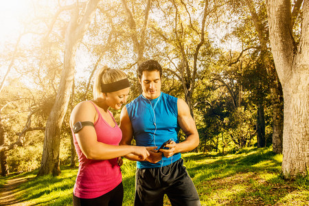 Two people exercising in forest having a rest LANG_EVOIMAGES