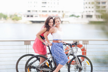 two persons only: Two young women on a bicycle