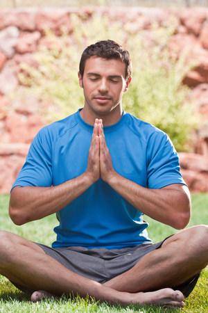 Man meditating outdoors LANG_EVOIMAGES