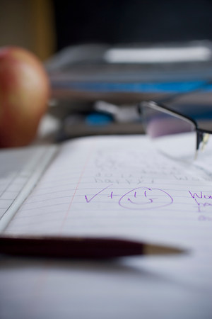 strategic focus: Marked school notebook with smiley face LANG_EVOIMAGES