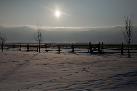 pastoral scenery: Sun shining over snowy field