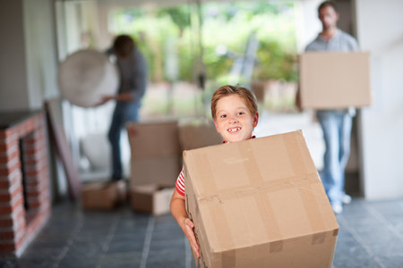 new age: Boy moving house carrying cardboard box LANG_EVOIMAGES