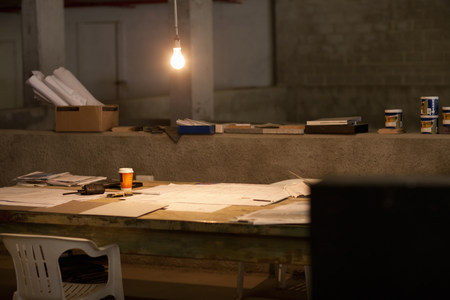 untidiness: Empty makeshift office at night