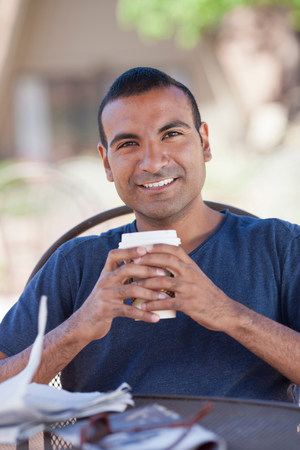 Man having cup of coffee outdoors