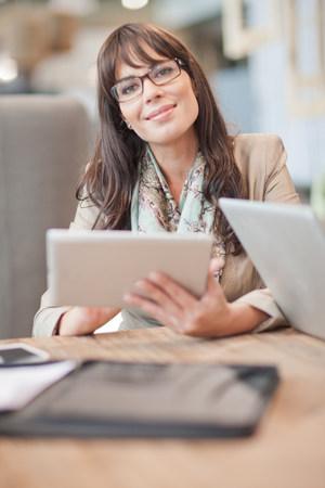 Mid adult businesswoman using digital tablet