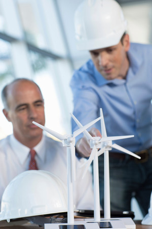 build in: Engineers with model wind turbines