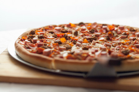 sultry: Close up of shovel and deep dish pizza