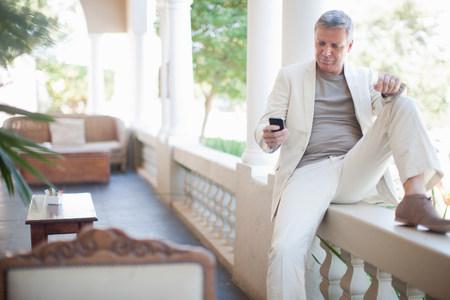 Mature man texting on smartphone