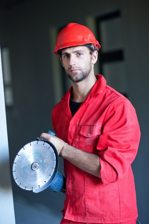 Portrait of building contractor with circular saw
