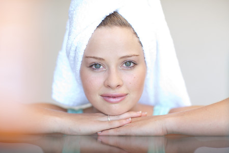 resourceful: Young woman wearing towel on head with chin on hands LANG_EVOIMAGES