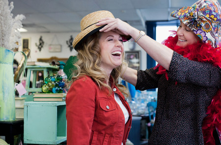 shopping buddies: Women shopping in thrift store