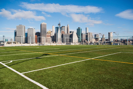 Soccer fields and Lower Manhattan skyline,New York City,USA