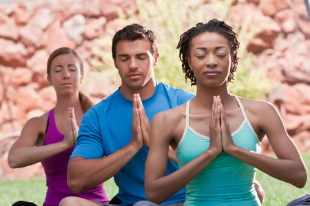 People meditating together outdoors