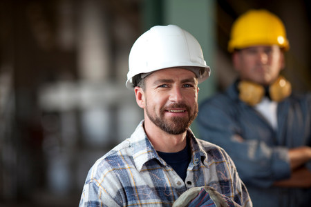 Industrial worker smiling in plant LANG_EVOIMAGES