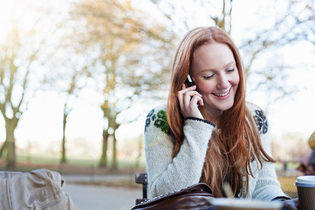 sidewalk talk: Woman talking on cell phone outdoors