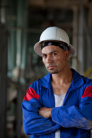 protects: Industrial worker standing in plant LANG_EVOIMAGES