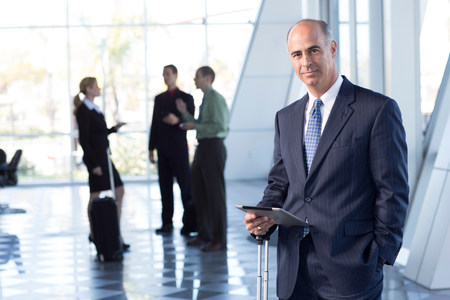 Mature businessman with digital table