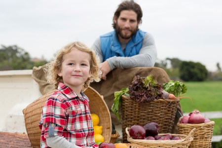 close up of onions in a basket: Father and son with produce in truck bed LANG_EVOIMAGES