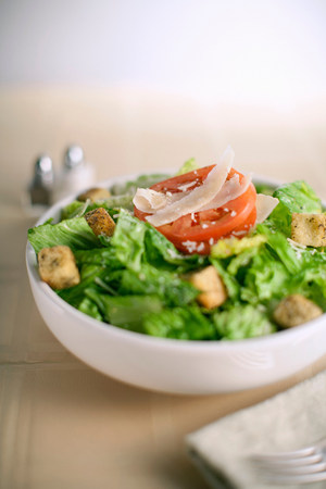 nourishing: Bowl of salad on table