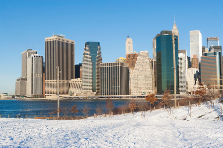 New York City skyline and snowy park LANG_EVOIMAGES