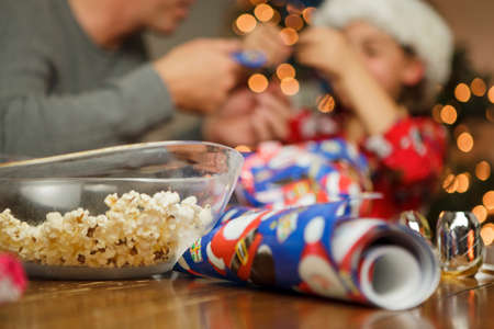 cropped out: Christmas gift wrap and popcorn